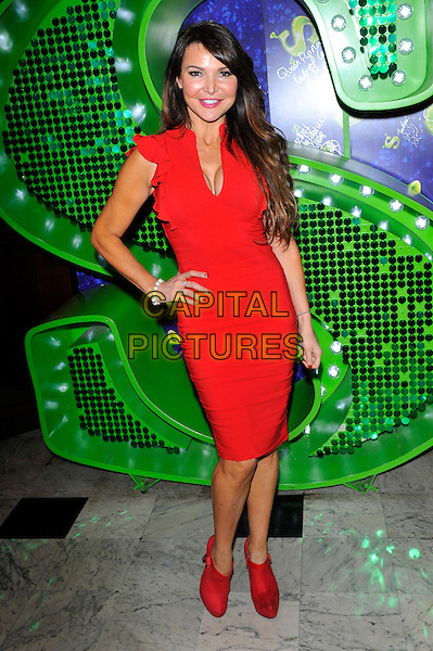 "Lizzie Cundy.Attends the Shrek ""Children in Need"" Performance, Theatre Royal, Dury Lane, Covent Garden, London, England..November 14th, 2012.full length red dress hand on hip cleavage booties shooboots shoes .CAP/CJ.©Chris Joseph/Capital Pictures."