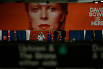 NEW YORK - APRIL 20: People walk at a subway station while images of David Bowie are displayed as art installations on April 20, 2018 in New York, NY. A Bowie exhibition inside Broadway-Lafayette subway station features fan-made works of Bowie-themed art paying tribute to one of rock's most iconic figures in New York City. The Bowie installation at Broadway-Lafayette is a collaboration between Spotify and the Brooklyn Museum.(Photo by Eduardo MunozAlvarez/VIEWpress)
