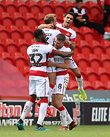 Doncaster Rovers' James Coppinger is mobbed after his cross is diverted in by Fleetwood Town's Wes Burns<br /> <br /> Photographer David Shipman/CameraSport<br /> <br /> The EFL Sky Bet League One - Doncaster Rovers v Fleetwood Town - Saturday 17th August 2019  - Keepmoat Stadium - Doncaster<br /> <br /> World Copyright © 2019 CameraSport. All rights reserved. 43 Linden Ave. Countesthorpe. Leicester. England. LE8 5PG - Tel: +44 (0) 116 277 4147 - admin@camerasport.com - www.camerasport.com