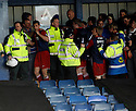 York players shield themselves from missiles after the Blue Square Premier play-off semi-final 2nd leg  match between Luton Town and York City at Kenilworth Road, Luton on Monday 3rd May, 2010..© Kevin Coleman 2010 ..