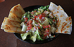At the Edison's Entertainment Complex in Edwardsville, this is the quesadilla salad, with iceberg and romaine lettuce, tossed with grilled chicken, corn, black beans, pico de gallo, and caramelized onions, all mixed with a margarita dressing for $7.95.