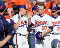 Clemson's Ben Paulsen (10) is congratulated after scoring the Tigers' only run a game between the Clemson Tigers and USC Gamecocks on March 2, 2008, at Doug Kingsmore Stadium in Clemson. Photo by: Tom Priddy/Four Seam Images