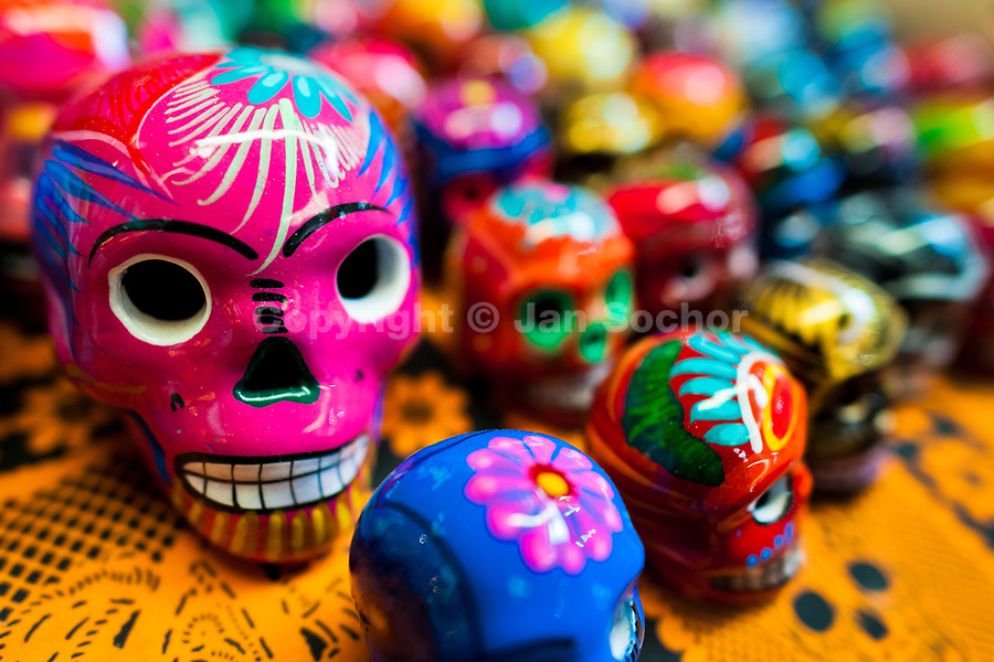 Colorful hand painted skulls are sold on the market during the Day of the Dead celebrations in Mexico City, Mexico, 28 October 2016. Skulls, skeletons and the other death symbols are used to adorn graves, altars and offerings during the Day of the Dead (Día de Muertos). A syncretic religious holiday, combining the death veneration rituals of the ancient Aztec culture with the Catholic practice, is celebrated throughout all Mexico. Based on the belief that the souls of the departed may come back to this world on that day, people gather at the gravesites in cemeteries, praying, drinking and playing music, to joyfully remember friends or family members who have died and to support their souls on the spiritual journey.