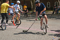 Governor's  Island, NY -  4 September 2010 - Unicyclists play hockey during the New York City Unicycle Festival on Governor's Island. Governor's Island was one of the most popularplaces this summer in New York City.