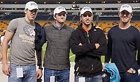 Evgeni Malkin (left) and other Pittsburgh Penguins pose with Pitt hats on. The Pitt Panthers defeated the USF Bulls 44-17 on September 29, 2011 at Heinz Field in Pittsburgh Pennsylvania.