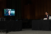 """United States Senator Mazie Hirono (Democrat of Hawaii), seen through a tv screen attending remotely, asks a question at a US Senate Judiciary Committee Hearing """"to examine COVID-19 fraud, focusing on law enforcement's response to those exploiting the pandemic"""" on Capitol Hill in Washington, DC on June 9, 2020. <br /> Credit: Erin Schaff / Pool via CNP/AdMedia"""