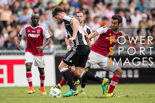 Juventus' player Alberto Cerri battles South China's player Vieira Junior Luiz Carlos for the ball during the South China vs Juventus match of the AET International Challenge Cup on 30 July 2016 at Hong Kong Stadium, in Hong Kong, China.  Photo by Marcio Machado / Power Sport Images