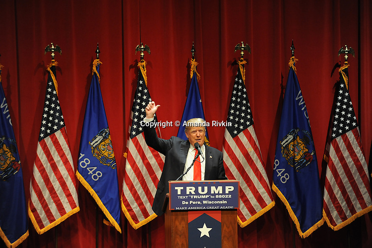 "Republican presidential frontrunner Donald Trump talks to a crowd of mostly students in the Webster Theater at St. Norbert College in De Pere, Wisconsin on March 30, 2016.  In a divergence from the usual fodder of political campaign stump speeches, Trump spoke about success, at one point remarking, ""Be around people less successful than you, you will be respected."""