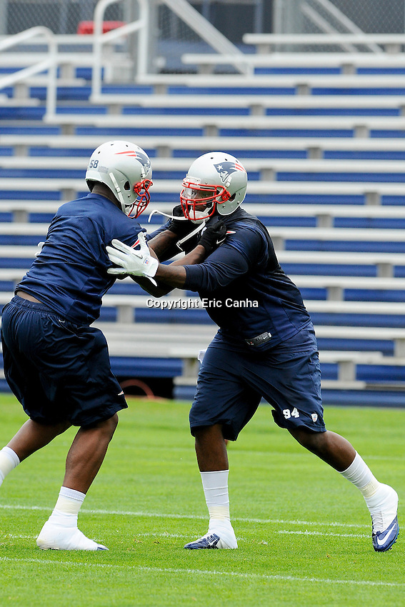 New England Patriots linebacker Marcus Benard (58) and defensive end Justin Francis (94) during the New England Patriots Organized Team Activities held at Gillette Stadium in Foxborough Massachusetts.  Eric Canha/CSM