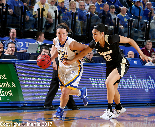 BROOKINGS, SD - MARCH 19:  Sydney Palmer #32 from South Dakota State eyes the clock while driving past Monica Burich #12 from Colorado during their second round WNIT game at Frost Arena March 19, 2017 in Brookings, South Dakota. (Photo by Dave Eggen/Inertia)