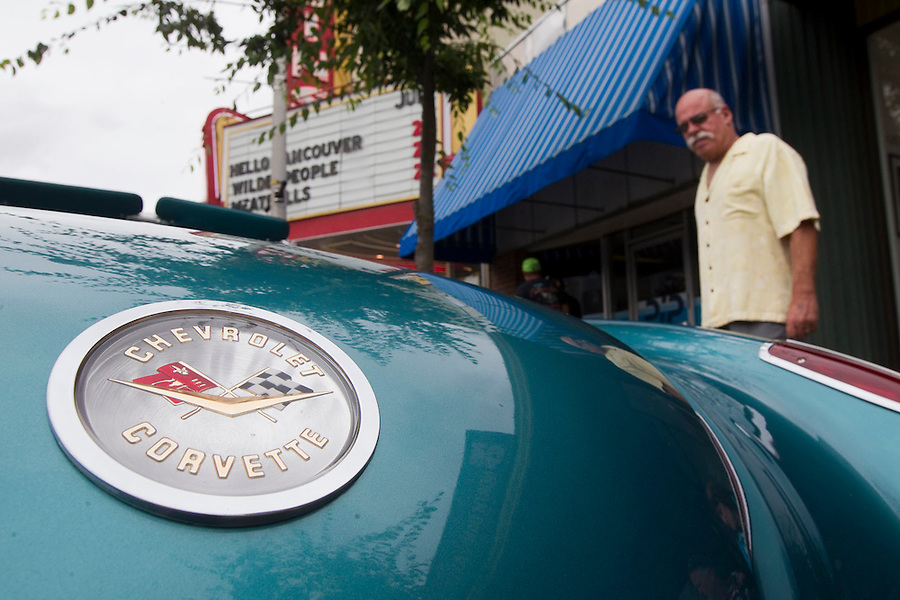 "Gregg Wilson admires a Corvette on display for ""Crusin' the Gut"" on Main Street in downtown Vancouver Saturday July 16, 2016. ""Cruisin' the Gut""  is an annual event in which antique car enthusiasts drive up and down main street,. (Photo by Natalie Behring/ for the The Columbian)"