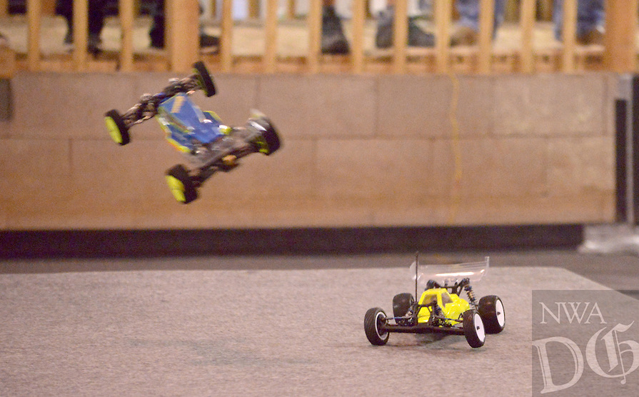 NWA Democrat-Gazette/BEN GOFF @NWABENGOFF<br /> A pair of 1/10-scale electric radio control race cars race around the off road short course on Sunday Nov. 29, 2015 at NWA R/C Raceway in Rogers. The shop holds races most weekends for a variety of types of 1/10-scale electric vehicles on two indoor tracks.