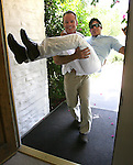 Dean Seymour, left, 44, carries his fiancé Philip Colavito, 43, over the threshold of a villa at The Parker Palm Springs hotel on Wednesday, June 11, 2008. The couple hopes to be one of the first couples to be married in Riverside County and will have the reception at the Parker.