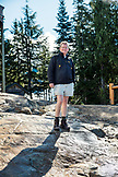CANADA, Vancouver, British Columbia, portrait of Bert Gamerschlag at the top of Grouse Mountain after finishing The Grind hike