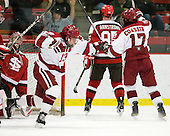 Michael Del Mauro (Harvard - 13) and Rence Coassin (Harvard - 17) celebrate Del Mauro's goal. - The Harvard University Crimson defeated the St. Lawrence University Saints 4-3 on senior night Saturday, February 26, 2011, at Bright Hockey Center in Cambridge, Massachusetts.