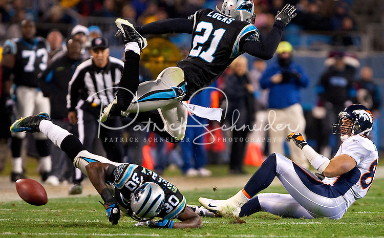 Carolina Panthers cornerback Ken Lucas (21) flies through the air against the Denver Broncos during an NFL football game at Bank of America Stadium in Charlotte, NC.
