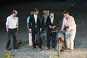 "Dinslaken, Germany. 12 August 2015. Steven Scharf as Accattone (far right). Performance of the Pier Paolo Pasolini play ""Accattone"" at Ruhrtriennale festival of the arts at Kohlenmischhalle of Schacht Lohberg in Dinslaken, North Rhine-Westphalia, Germany. Accattone is directed by festival director Johan Simons with music by Johann Sebastian Bach conducted by Philippe Herreweghe. With Steven Scharf as Accattone."