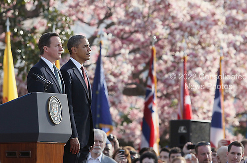 United States President Barack Obama welcomes British Prime Minister David Cameron during an official arrival ceremony at the South Lawn of the White House March 14, 2012 in Washington, DC. Prime Minister Cameron was on a three-day visit in the U.S. and he was expected to have talks with President Obama on the situations in Afghanistan, Syria and Iran. .Credit: Mark Wilson - Pool via CNP
