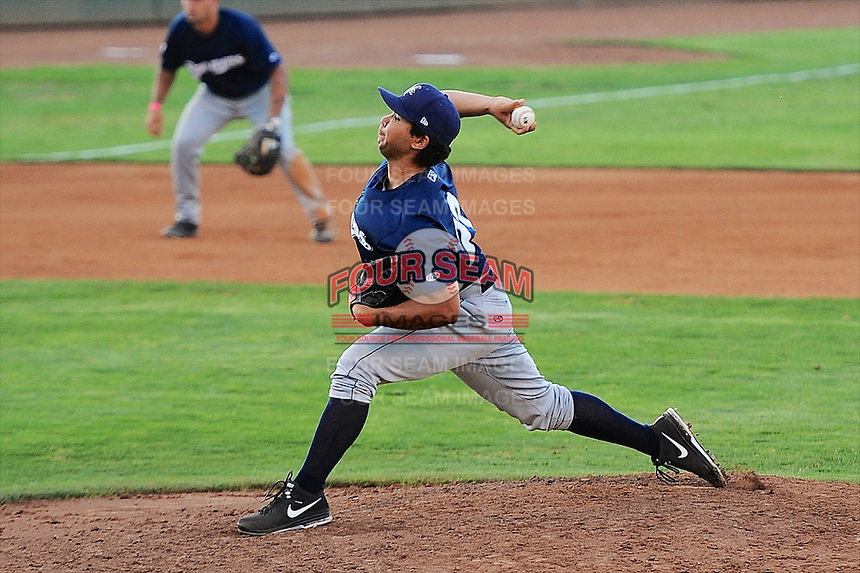 Helena Brewers relief pitcher Eduard Reyes (23) delivers a pitch to the plate against the Ogden Raptors at Lindquist Field in Ogden Utah on July 20, 2013.  (Stephen Smith/Four Seam Images)