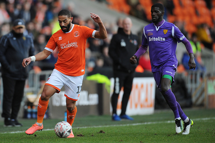 Blackpool's Liam Feeney under pressure from Maidstone United's Saidou Khan<br /> <br /> Photographer Kevin Barnes/CameraSport<br /> <br /> Emirates FA Cup Second Round - Blackpool v Maidstone United - Sunday 1st December 2019 - Bloomfield Road - Blackpool<br />  <br /> World Copyright © 2019 CameraSport. All rights reserved. 43 Linden Ave. Countesthorpe. Leicester. England. LE8 5PG - Tel: +44 (0) 116 277 4147 - admin@camerasport.com - www.camerasport.com