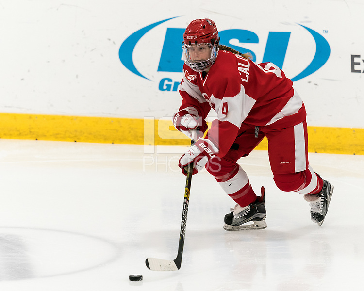 WORCESTER, MA - FEBRUARY 08: Alexandra Calderone #4 of Boston University controls the puck during a game between Boston University and College of the Holy Cross at Hart Center Rink on February 08, 2020 in Worcester, Massachusetts.