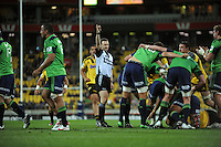 Referee Keith Brown awards a scrum penalty to the Highlanders during the Super 15 rugby match between the Hurricanes and Highlanders at Westpac Stadium, Wellington, New Zealand on Saturday, 17 March 2012. Photo: Dave Lintott / lintottphoto.co.nz