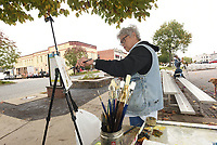 NWA Democrat-Gazette/FLIP PUTTHOFF <br />ARTIST'S EYE<br />Kay Pickett (left) and Julie Hays, both with Plein Air Painters of the Ozarks, paint Wednesday Oct. 10 2018 pictures of buildings in downtown Rogers along South First Street. The group of artists meets and paints at various locations in the region each Wednesday.