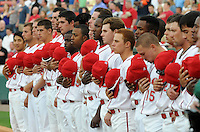 Members of the Greenville Drive, Class A affiliate of the Boston Red Sox, listen to the National Anthem before a game against the Augusta GreenJackets on Opening Day, April 7, 2011, at Fluor Field at the West End in Greenville, S.C. Photo by Tom Priddy / Four Seam Images