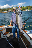 ALASKA, Ketchikan, Captain Tony shows off his catch while fishing the Behm Canal near Clarence Straight, Knudsen Cove along the Tongass Narrows