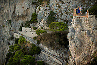 Barbara Brosher is seen at an overlook above Via Krupp on Monday, Sept. 21, 2015, on the island of Capri in Italy. (Photo by James Brosher)