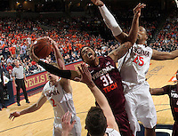 Virginia Tech forward Jarell Eddie (31) is surrounded by Virginia  defenders during the game Tuesday in Charlottesville, VA. Virginia defeated Virginia Tech73-55.