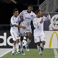 San Jose Earthquakes forward Chris Wondolowski (8) celebrates his goal with teammates. In a Major League Soccer (MLS) match, the San Jose Earthquakes defeated the New England Revolution, 2-1, at Gillette Stadium on October 8, 2011.