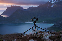 Camera and tripod on mountain peak, Vestvågøy, Lofoten Islands, Norway