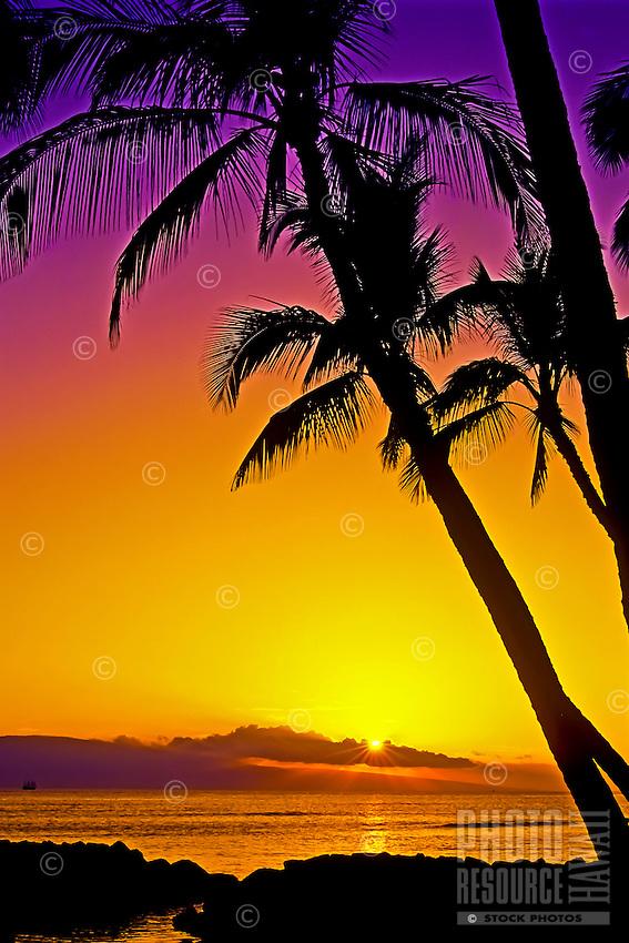 A vibrant sunset over the island of Lanai, as seen from Launiupoko, Maui.
