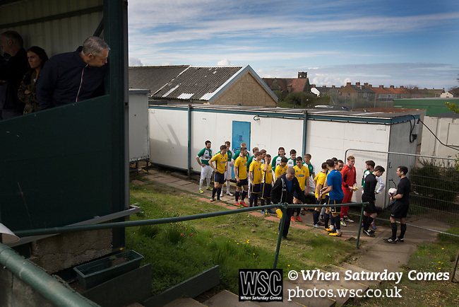 The two teams waiting outside the dressing rooms at Mount Pleasant before Marske United (in yellow) take on Billingham Synthonia in a Northern League division one fixture. Formed in 1956 in Marske-by-the-Sea, the home club had secured automatic promotion to the Northern Premier League two days before and were in the midst of a run of six home games in 10 days as they attempted to overtake Morpeth Town to win the league. They won this match 6-1 against already relegated Billingham, watched by a crowd of 196.