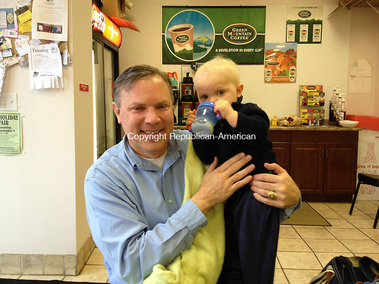 BEACON FALLS, CT - 07 November 2013 - 110713QL01 - Democratic Selectman Christopher J. Bielik, first selectman-elect in Beacon Falls, holds his 1-year-old son, Aleksander Krzysztof, inside the Beacon Falls Bakery & Deli on North Main Street on Thursday afternoon. Quannah Leonard Republican-American