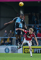Anthony Stewart of Wycombe Wanderers beats Lee Barnard of Crawley Town in the air during the Sky Bet League 2 match between Wycombe Wanderers and Crawley Town at Adams Park, High Wycombe, England on 28 December 2015. Photo by Andy Rowland / PRiME Media Images