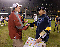 California head coach Jeff Tedford shakes hands with Washington State head coach Paul Wulff after the game at AT&T Park in San Francisco, California on November 5th, 2011.  California defeated Washington State, 30-7.
