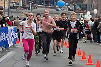 Moscow, Russia, 12/09/2010..Runners approach the finish line at the 30th annual Moscow International Marathon.