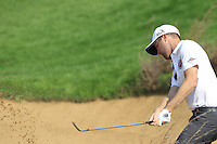 Chris Kirk (USA) chips from a bunker at the 6th green during Sunday's Final Round of the 2014 BMW Masters held at Lake Malaren, Shanghai, China. 2nd November 2014.<br /> Picture: Eoin Clarke www.golffile.ie