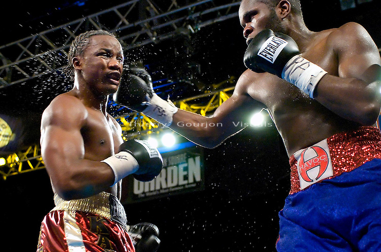 Sechew Powell (r) on the attack during  his 10 rounds junior Middleweight Fight against Kassim Ouma at MSG in New York City on 08.05.06. Ouma won by Unanimous decision.