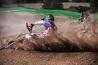 Rider and photographer at Spanish Motocross Championship at Albaida circuit (Spain), 22-23 February 2014