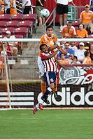 Chivas USA forward Maykel Galindo (11) and Houston Dynamo defender Geoff Cameron (20) go up for the header.  Houston Dynamo defeated CD Chivas USA 1-0 at Robertson Stadium in Houston, TX on June 10, 2009.