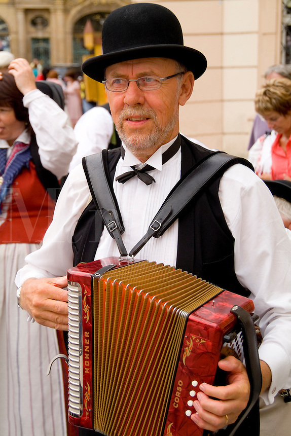 Man in traditional attire playing accordian, Prague, Czech Republic
