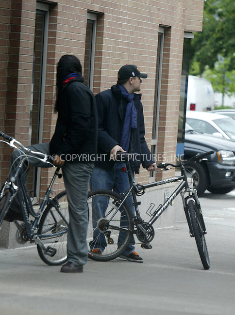 WWW.ACEPIXS.COM ** ** **EXCLUSIVE!!! FEE MUST BE NEGOTIATED BEFORE USE!!!***....NEW YORK, MAY 26, 2005....Leonardo DiCaprio hands off a knit hat to an unidentified long haired friend outside his downtown home. From there the two take off on bikes to the Water Taxi in the West Village. Leo DiCaprio's friend appears to be riding a Giant bicycle that Giselle Bundchen rode around town last summer. From there the two get on the Water Taxi at Pier 45 heading to the USS Intrepid..... Please byline: Philip Vaughan -- ACE PICTURES... *** ***  ..Ace Pictures, Inc:  ..Craig Ashby (212) 243-8787..e-mail: picturedesk@acepixs.com..web: http://www.acepixs.com