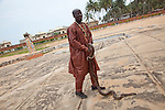 A man carries a royal python in Ouidah, Benin.  In this historic town, pythons are viewed as sacred animals.