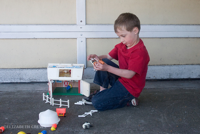 Berkeley CA Boy, four, involved in fantasy play with toy farm and farm animals  MR