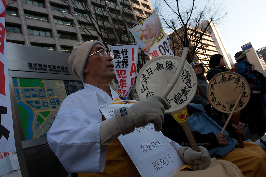 A Buddhist Monk and nun sport protesters at an anti-nuclear power demo and occupy Tokyo protest outside the Ministry of the Economy, Trade and Industry (METI) in Tokyo, Japan. Friday 27th January 2012. The protest has been running from September 2011 and was scheduled for forcible eviction by police at 5pm on January 27th as the camp had been declared a fire risk by Minister Yukio Edano, with around 500 supporters and protesters turning up to resist the eviction however the camp was still in place the night of the 27th.