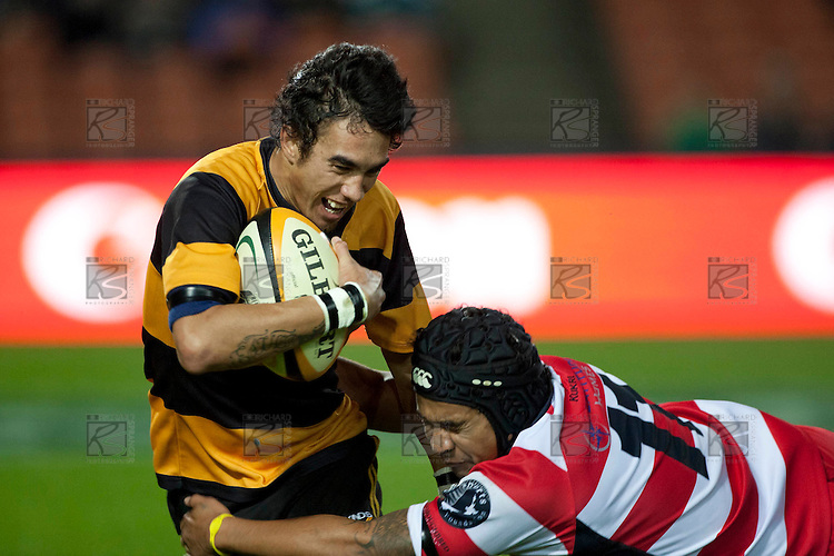 Bombay fullback Charles Teraitua is hit in a tackle by Taavili Patea. Counties Manukau Premier Club Rugby game played between Karaka and Bombay at Waikato Stadium as a curtain raiser to the Chiefs vs Highlanders Super 15 rugby match on May 7th 2011. Karaka won the game 19 - 17.