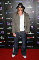 KID ROCK (Robert James Ritchie).At SWAGG VIP Kid Rock Concert at the Joint inside the Hard Rock Hotel and Casino, Las Vegas, Nevada, USA,.7th January 2010..full length jeans jacket trainers flared flares sunglasses goatee facial hair white t-shirt hat grey gray shirt gold chain necklace khaki .CAP/ADM/MJT.© MJT/AdMedia/Capital Pictures.